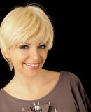 Beautiful girl with short hair. Pretty woman with short blond hair Stock Image