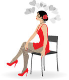 The beautiful girl in a short red dress. And stockings sits on a chair Royalty Free Stock Photos