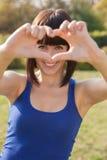 Beautiful girl show love sign Stock Photo