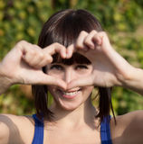 Beautiful girl show love sign Royalty Free Stock Photography