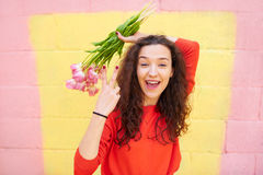 Beautiful Girl Show two fingers over colorful background Stock Images