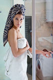 Beautiful girl after a shower in a white towel Royalty Free Stock Images