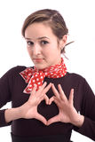 Beautiful girl showing a heart with her fingers Stock Images