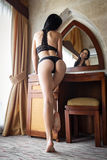 Beautiful girl showing her sexy ass in a black lingerie Royalty Free Stock Images