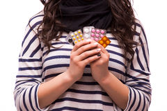 Beautiful girl showing many differents medicines tablets Stock Image
