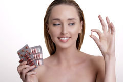 Beautiful girl showing many differents medicines Stock Images