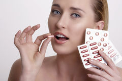 Beautiful girl showing many differents medicines Stock Photo