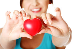 Beautiful girl showing red heart. Stock Photography
