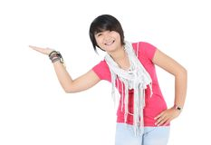Beautiful girl showing something. On the palm of her hand isolated white background Stock Image