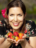 Beautiful girl showing strawberries Royalty Free Stock Photography