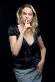 Beautiful girl showing to keep silence Stock Photo