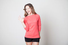 Beautiful girl shows hands symbol OK Royalty Free Stock Images