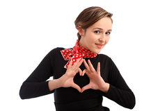 Beautiful girl shows a heart-shaped Royalty Free Stock Photos
