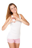 Beautiful girl shows a heart symbol Stock Image