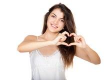 Beautiful girl shows a heart symbol Stock Photo