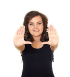 Beautiful girl shows her hands frame. Isolated on white background Royalty Free Stock Photos