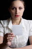 The beautiful girl shows a sheet of paper. The beautiful girl shows sheet pays attention Royalty Free Stock Photo