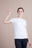 Beautiful girl shows signs of hands Stock Image
