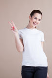 Beautiful girl shows signs of hands Royalty Free Stock Images