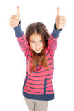 Beautiful girl shows two thumbs up sign. Beautiful girl on a white background shows two thumbs up sign Royalty Free Stock Photography