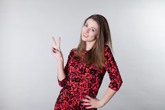 Beautiful girl shows winning fingers Royalty Free Stock Images