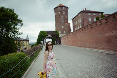 Beautiful girl during sightseeing old castle in Cracow, Wawel. Stock Photography