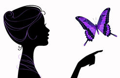 Beautiful girl silhouette with butterfly. Beautiful girl silhouette with violet butterfly Stock Photos
