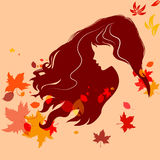 Beautiful girl silhouette with flying hair and colorful autumn l Stock Images