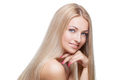 Beautiful girl with silky blond hair Stock Photos
