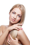 Beautiful girl with silky blond hair Royalty Free Stock Photography
