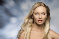 Beautiful girl with silky hair Stock Photos
