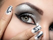Beautiful girl with the silver makeup and nails. Beautiful girl with the silver makeup of eyes and metal nails. Fashion woman portrait. Closeup shot of female royalty free stock photos