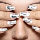 Beautiful girl with the silver metal nails. Closeup shot royalty free stock photos