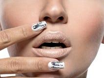 Beautiful girl with the silver metal nails. Closeup shot stock photos