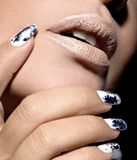 Beautiful girl with the silver metal nails. Stock Photos