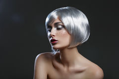 Beautiful girl in silver wig stock images