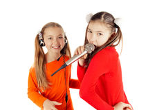 Beautiful girl singing into a microphone Royalty Free Stock Photos