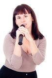 Beautiful girl singing into the microphone Royalty Free Stock Images