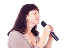 Beautiful girl singing into the microphone Stock Photos