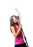 Beautiful girl singing a popular song Royalty Free Stock Photo
