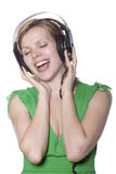 Beautiful girl singing to music Royalty Free Stock Image