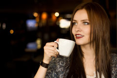 Beautiful girl sipping coffee Stock Photography