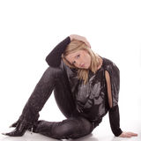 Beautiful girl sit on floor. Over white background Royalty Free Stock Photos
