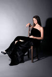 Beautiful girl sit on stool Stock Image