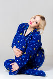 Beautiful girl siting in funny pajamas Stock Photo