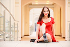 Beautiful girl sits on floor Stock Images