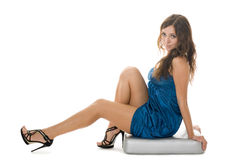 Beautiful girl sits on a pillow Royalty Free Stock Photography