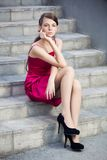 Beautiful girl. Sits on the steps Stock Images