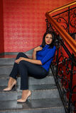 Beautiful girl sits on the steps Royalty Free Stock Photography