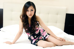 Beautiful girl sitting in bed Stock Photos